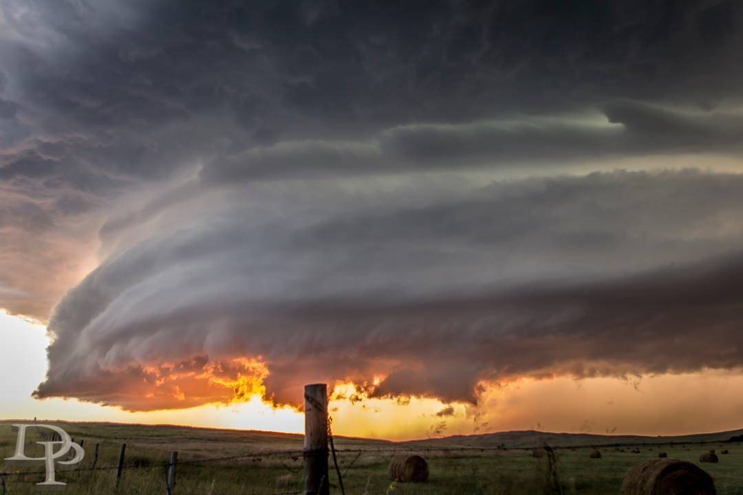 Here is a shot from near Tyron, NE on 8/17/2011 ... this storm produced a brief tornado and some decent size hail but by the time we raced to the area from NE CO we were only met by a decaying cell and a beautiful sunset . Shot at ISO100 F/5 1/30sec