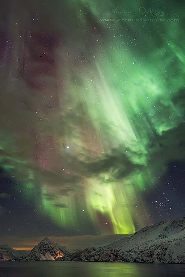 "March 3, 2014 - ""Aurora shower"" West of Alta in Norway 0h35 iso1600 24mm f2,8 11sec 2photos superposition"