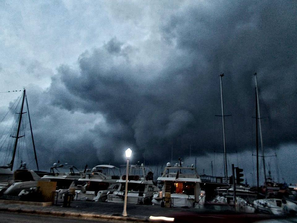 Crazy rotating storm covering Rhodes Greece traditional harbour 28/3/2014.fresh shot from the monster!!!