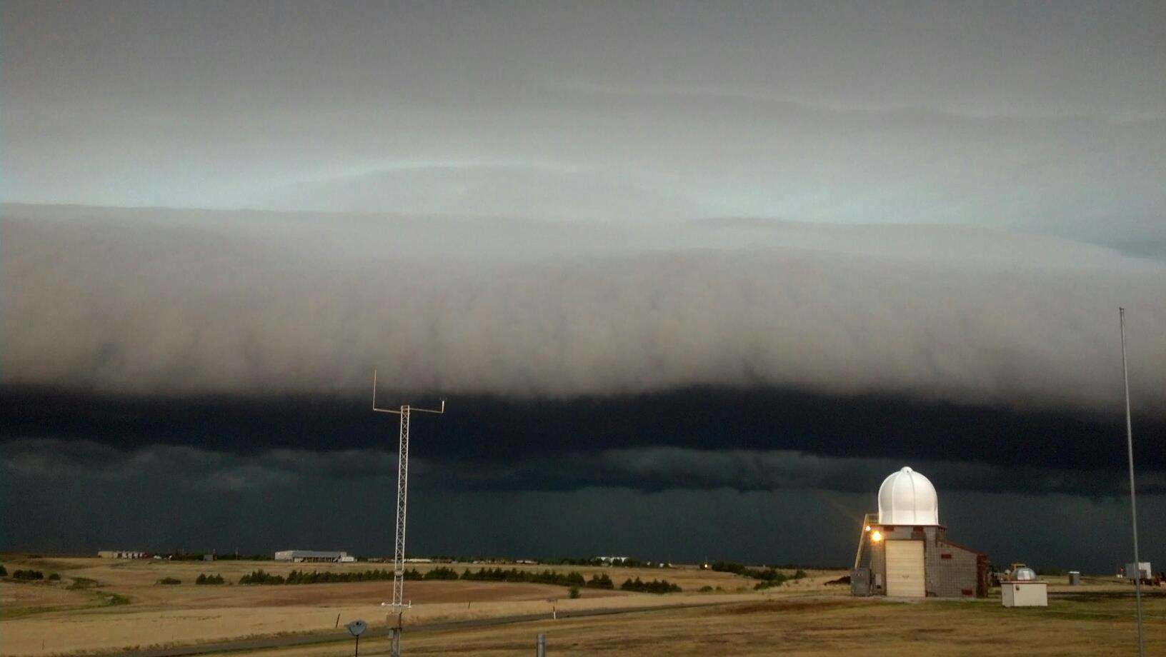 Severe Thunderstorm heading into the Dodge City, Kansas, National Weather Service Office. The front part is called a shelf cloud or roll cloud and contains severe winds of 60 mph plus. Photo taken on 12 Aug 2012.