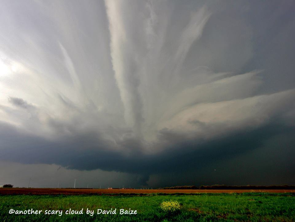 Chased 3 waves of supercells in N TX yesterday, which produced numerous wall clouds, huge hail, and some funnels. Really liked this structure.. and a teeny, tiny (spotter) helicopter on the mid-right side just under the cloud. (Little Elm, TX)