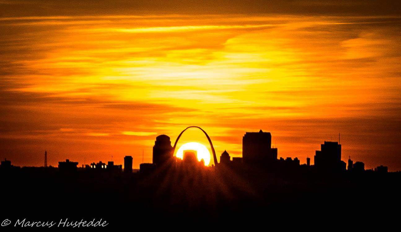 The sun sets directly under the arch last night in St. Louis, MO (4-11-14). 1/100 sec f/18 ISO 100