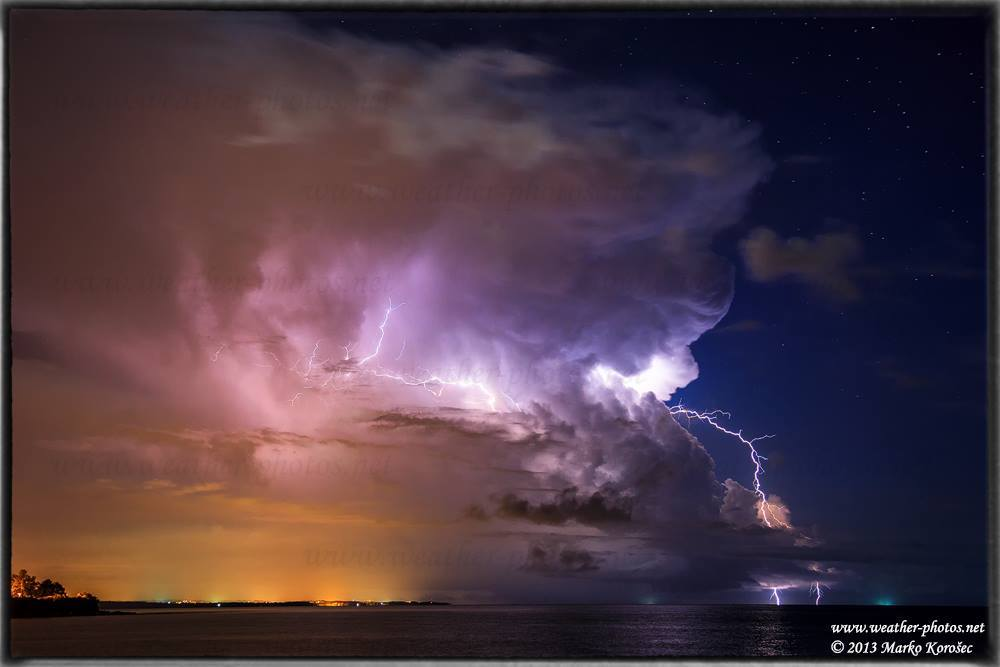 Lightning strikes outside the main Cb tower of an isolated storm with stars shining above the Adriatic sea, Croatia. Taken on August 28th, 2013.