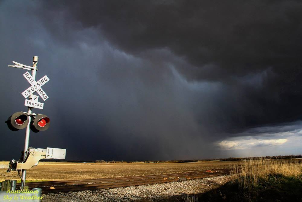 Railroads and storms just fit into the Kansas Landscape, Near Lost Springs KS, 7 April 2014.Photo: Jane ONeill