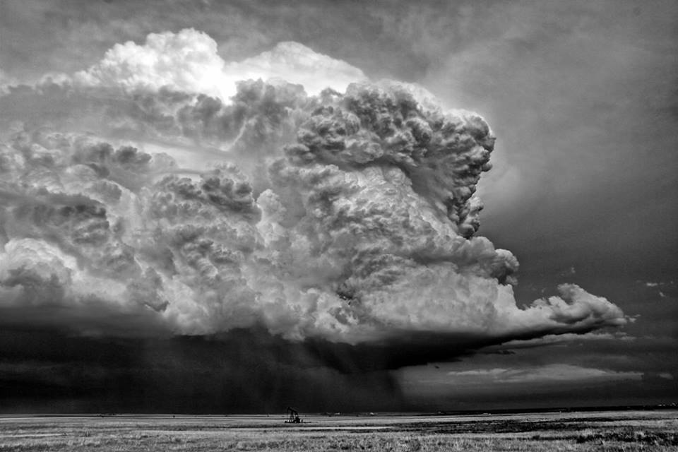 Convection dwarfs a pumpjack in western Kansas. This amazing updraft became tornado warned for a short time as the updraft pulse approached 50,000'...Photo: Jane ONeill/Clyve Herbert