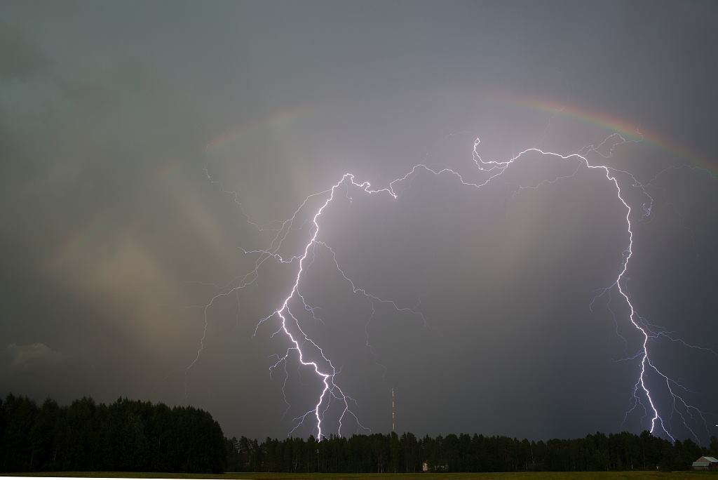 Hi. Here is maybe my best daytime bolt ever. Kalajoki, Finland 2011. Taken with lightning trigger and 5D mark II.