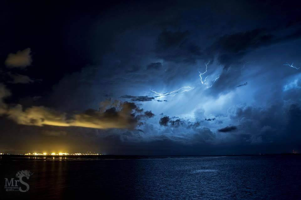 A large lightning active storm leaves the docks and heads out to sea. The show lasted hours. Captured from Manly Queensland Australia.