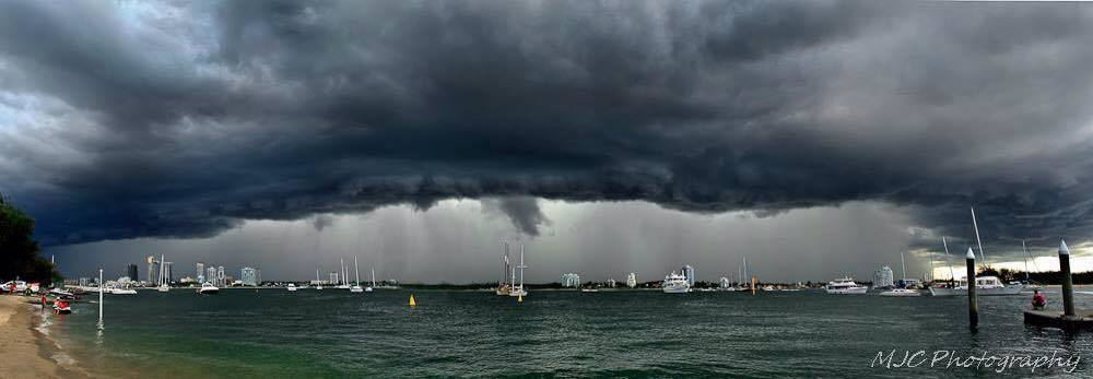 Within minutes of taking this 8 image pano I was hunkering down in my car for cover.. Love the curtain of torrential rain in the middle.. Taken at the Gold Coast Seaway QLD Aus 6th April 2014..