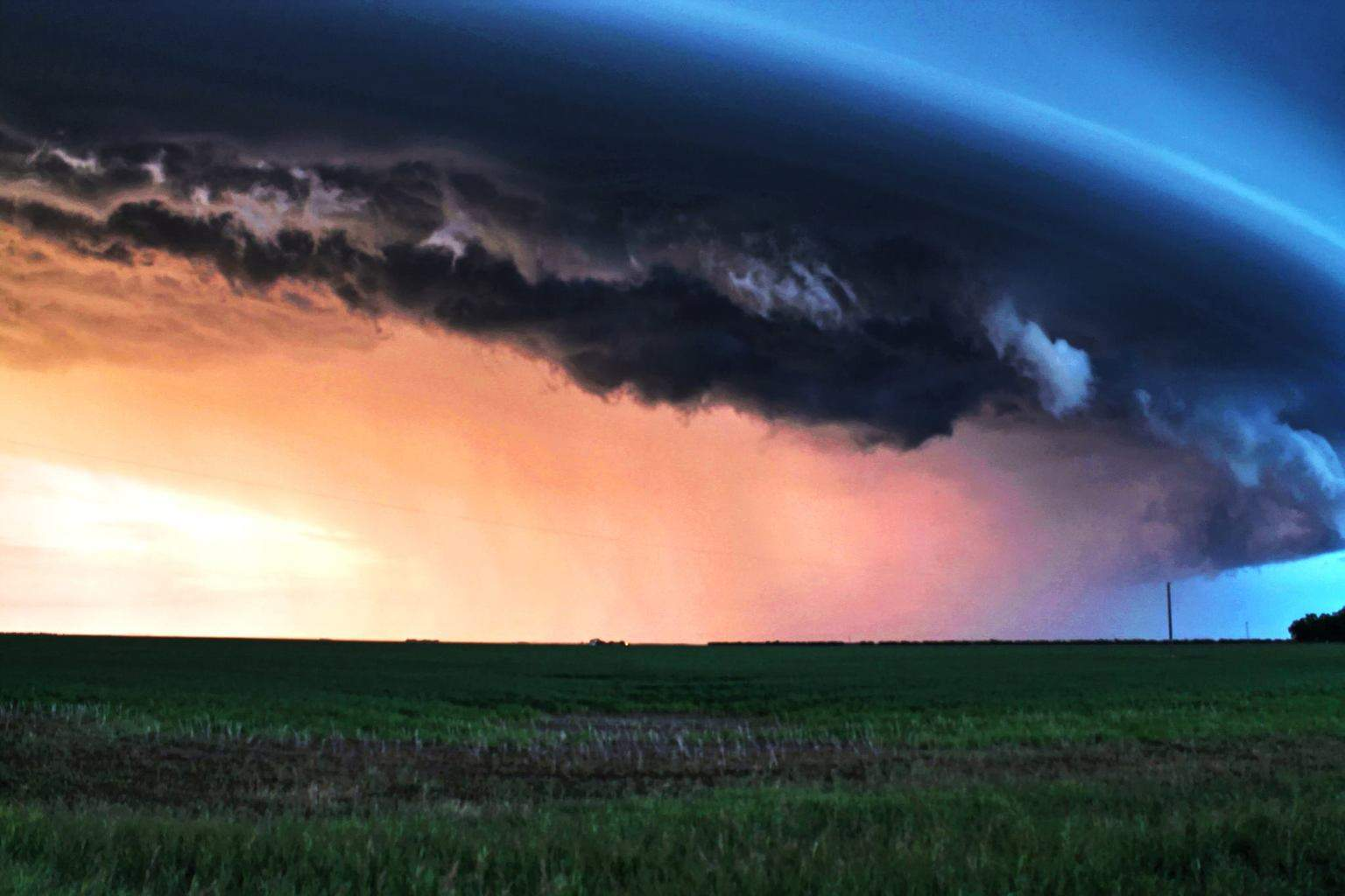A 2013 Saskatchewan summer supercell this is getting near the end of its life cycle this cell went for approximately 6 hours and traveled about 350 miles before is dissipated the sun was starting to set here and was low enough on the horizon to give some great back back lighting to this one.