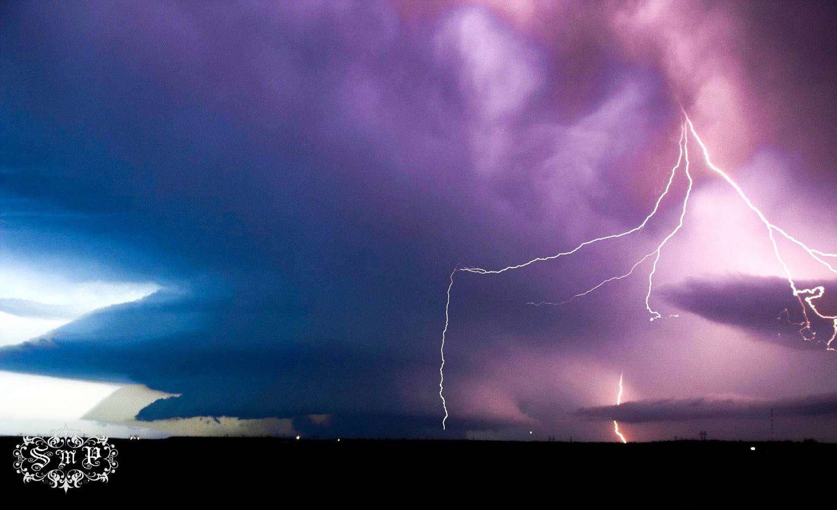 April 9, 2012 Taken a few miles East of Quanah, TX... beautiful Structure Great CG Lightning... The Colors are real... Enjoy...