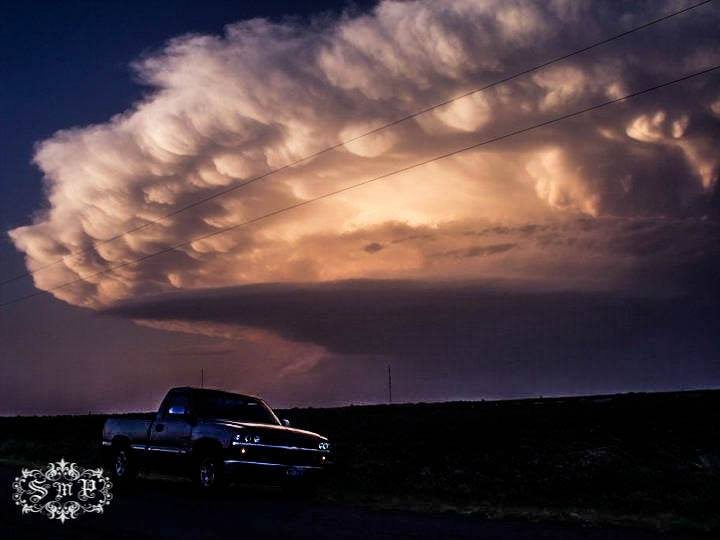 June 16, 2011... Thunderstorm moving off to the North East... I was located a mile South of Vernon... This was before I got really deep into storm/weather photography... Not sure if there is a rule about Personal Vehicles in shots, if so I apologize...