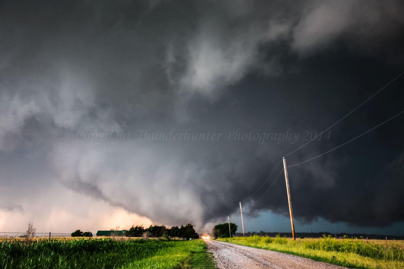 The deadly El Reno tornado touches down under a mesocyclone that was almost on the ground. This tornado quickly became multi-vortex, then transformed into a large wedge before further intensifying and growing into the widest tornado ever measured at 4.2km wide.