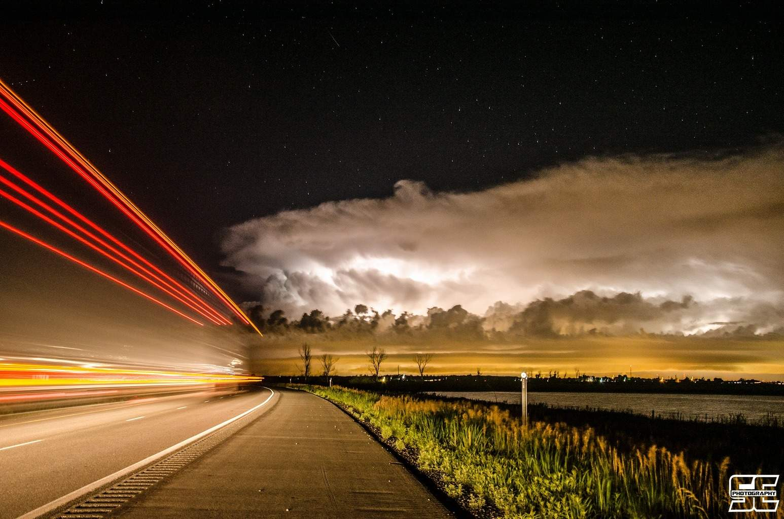 Unique shot of car trails leading into the severe storm with insane lightning south of Omaha, NE during the early morning hours of June 29th.