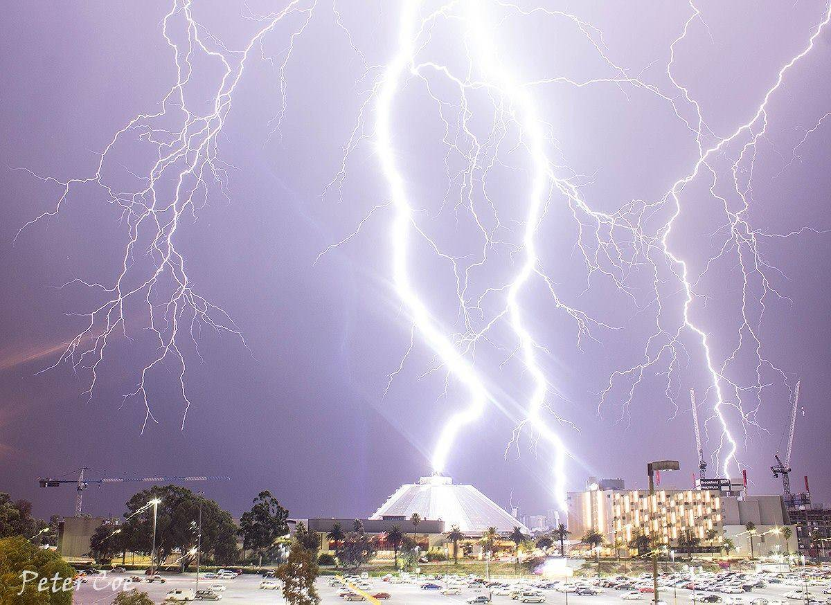 Lightning strikes an entertainment complex during an intense thunderstorm in Perth, Western Australia early this morning. These bolts landed around 440m from where I was standing.