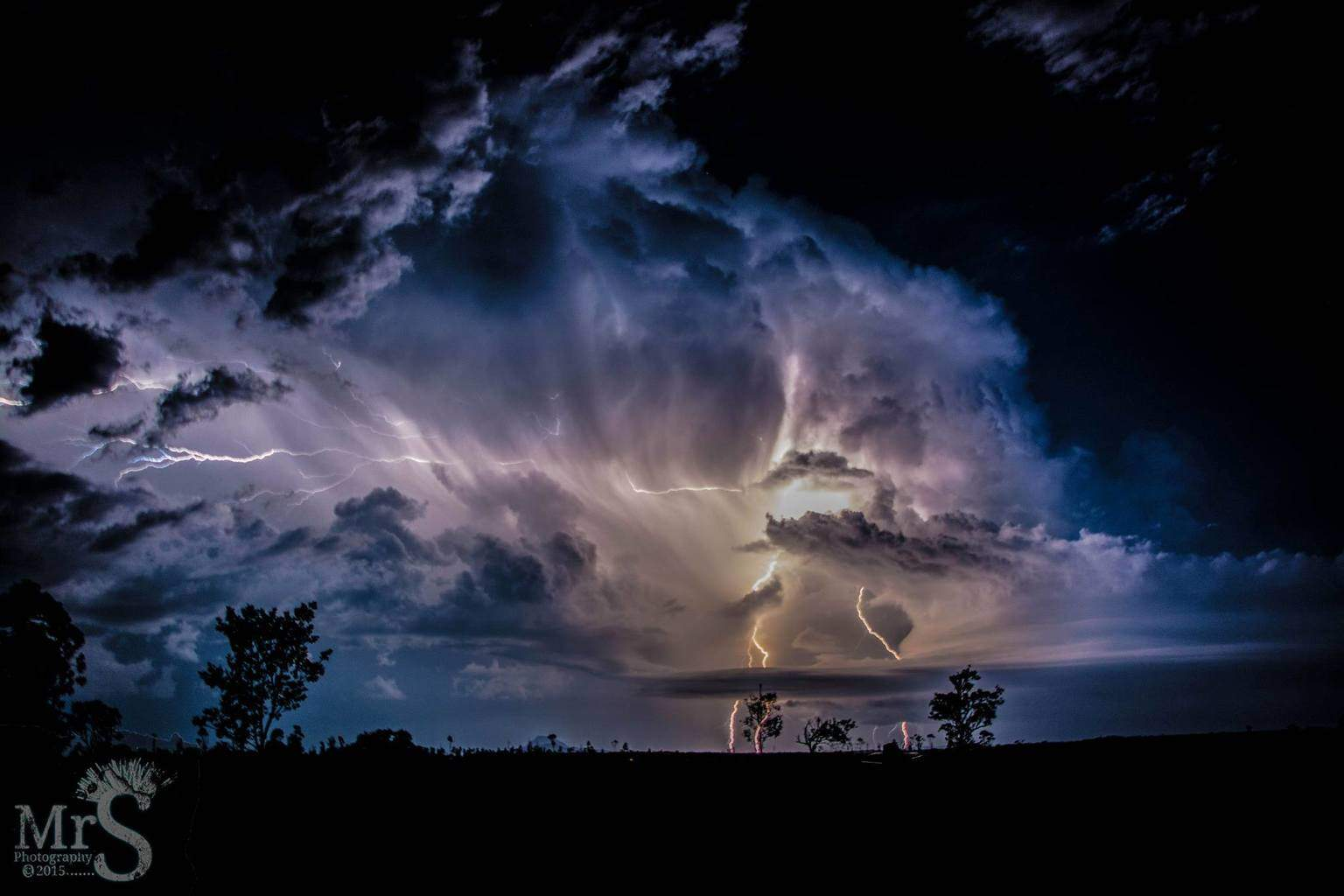 A massive storm last night over inland South East Queensland, Australia. The color's started to change as the smoke from spot fires were sucked into the cloud with the inflow's. Made for an amazing view. I must have captured 30 like this and hundreds of smaller. An awesome night.