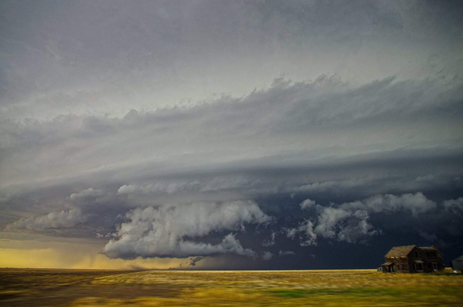 A supercell that had some amazing structure, about to overtake a house in southwest Kansas, This supercell was dropping baseball size hail at the time of the photo. This part of Kansas was also in an exceptional drought at the time. Taken:06/01/2014