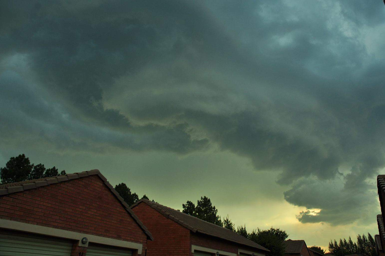A spectacular but very short lived shelf cloud as it moved over Moreleta Park in Pretoria, South Africa early this evening and quickly began breaking apart.