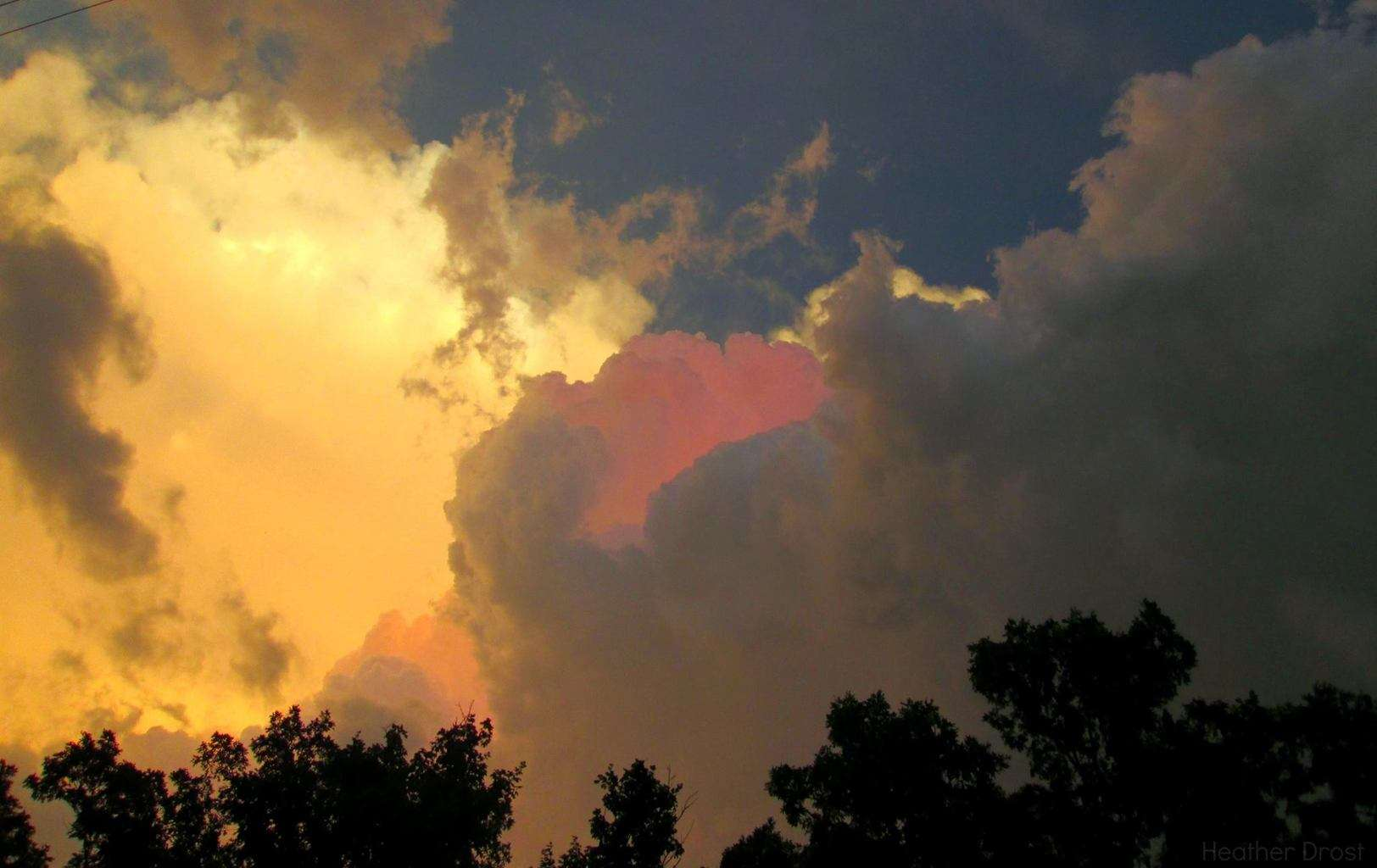 Here are some colorful cumulus cloud tops, each layer being lit up a different color at sunset after the storm passed through. I thought the vibrant pink in the middle was truly amazing. I captured this photo last July, I can't wait until storm season picks up again here this year.