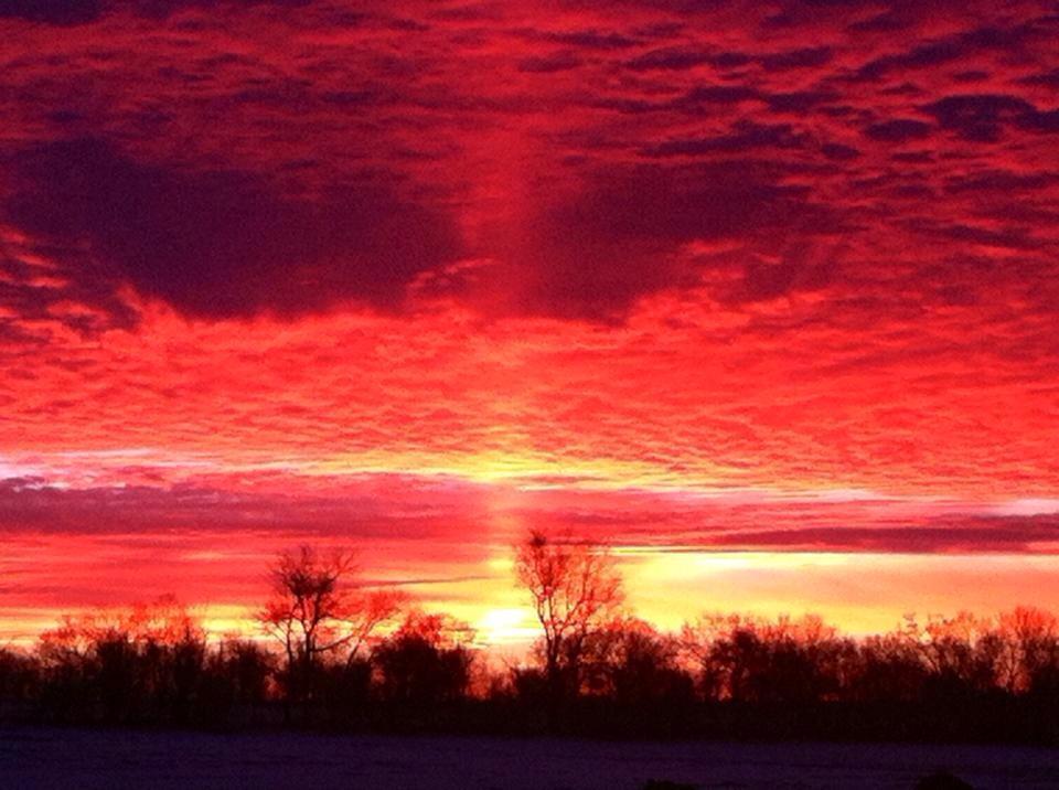 Sun pillar at sunrise in North Dakota