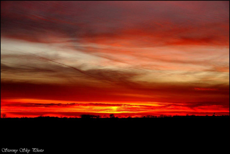 A fiery sunset with a sun pillar