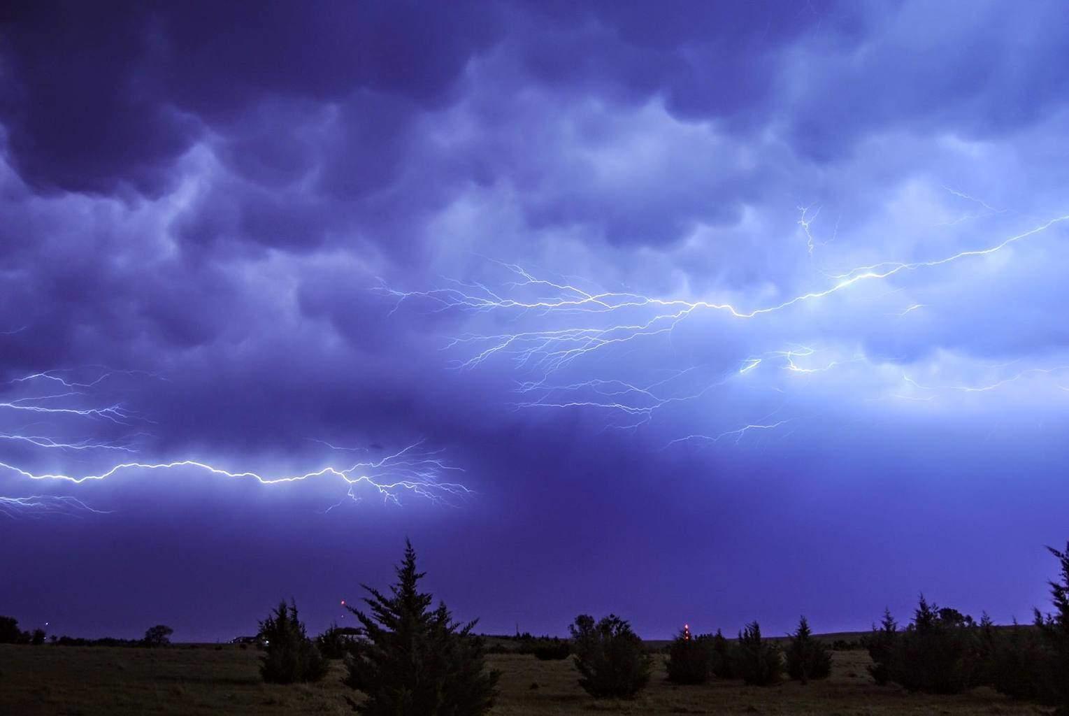 Anvil crawling lightning and mammatus after dark near Bennington, KS on August 31, 2014.