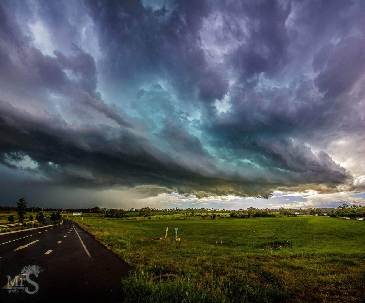 Incoming hail. Today a storm built up right near home. As the sun was lowering to set i expected it to go pink. But the light never reached so the nicest purple tinge happened amongst the blue/green instead. This is 6 x 10mm verticle images stitched.