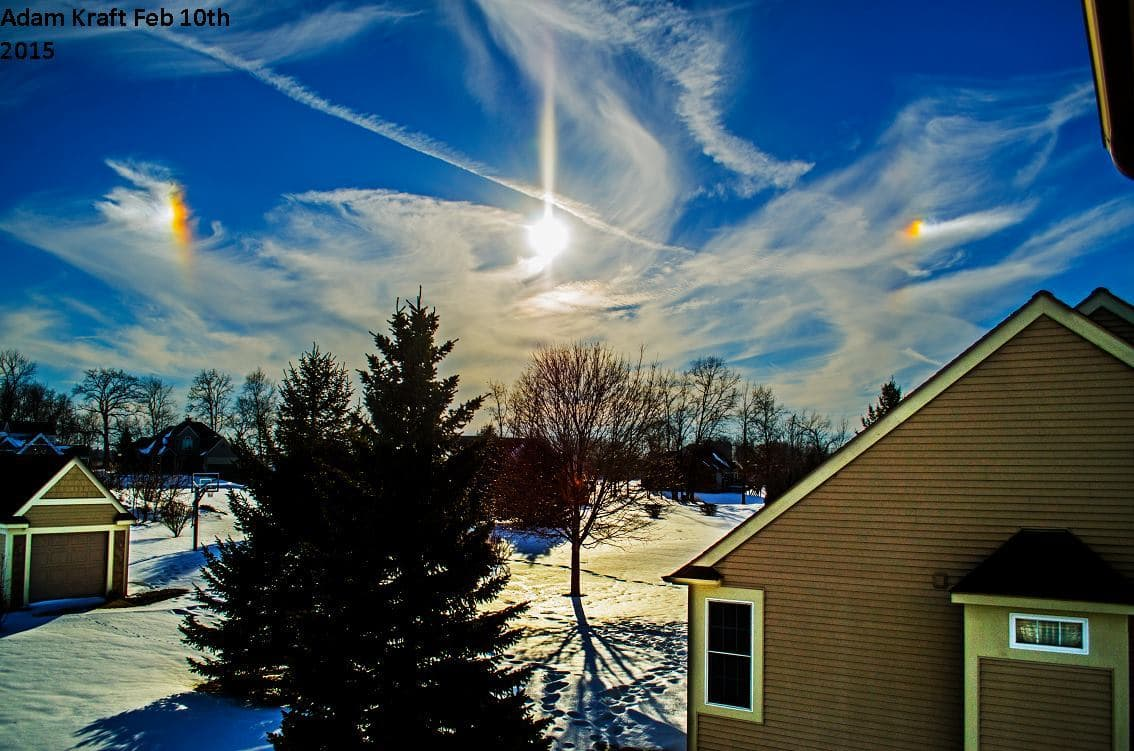 Great Michigan winter scene this afternoon with a double sundog. I was unable to determine if the pillar is a lens artifact or a sun pillar. Cool looking regardless.Way too bright to actually look at to determine.