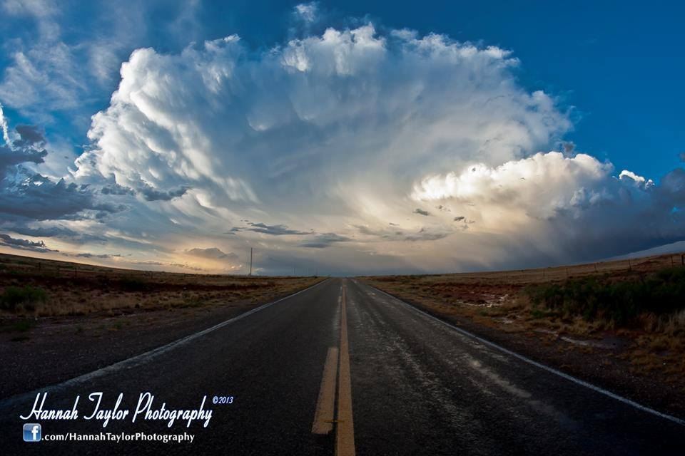 """""""Chasing the Dream"""". The fading fantail of a towering supercell between Roswell & Ft. Sumner, NM. 05-24-2014. Canon 40D & Rokinon 8mm lens."""