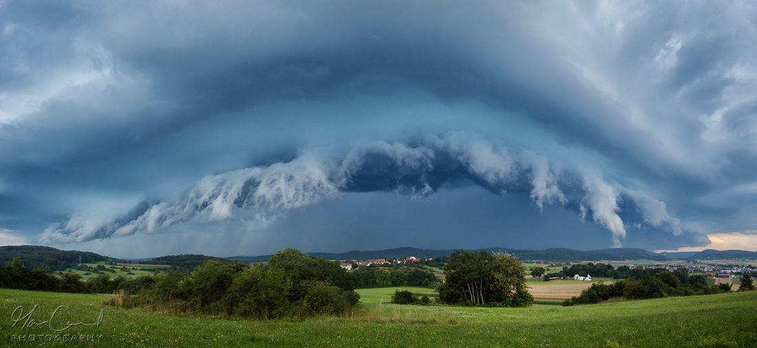 Vigorous arcus clouds - Panoramic shot of a thunderstorm on August 3rd in the Swabian Jura, Germany