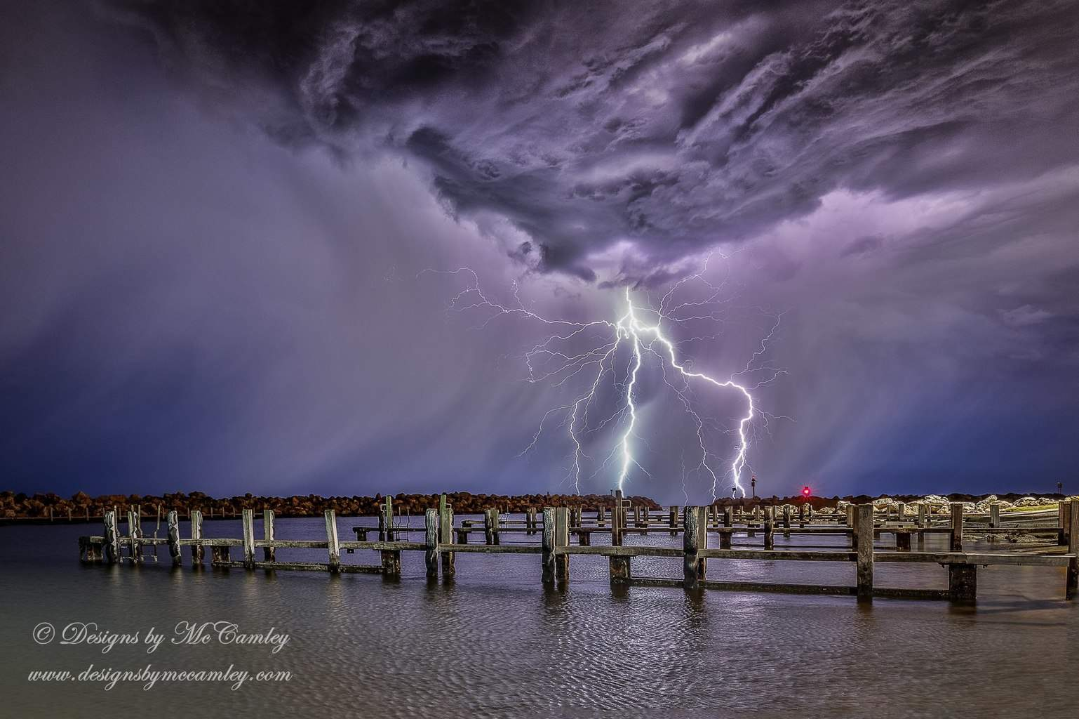 27th November 2014 3:48am Ocean Reef marina in Western Australia. Had I known the dark clouds above me looked like that I might not have been brave/silly enough to get this shot. My first half decent lightning shot.