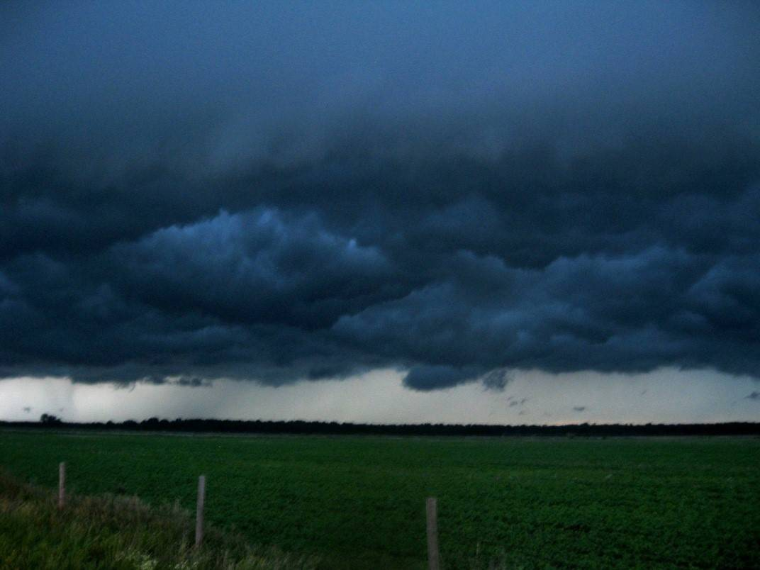 Derecho (a long-lived line of damaging severe storms) rolls over Northwest Indiana at twilight.