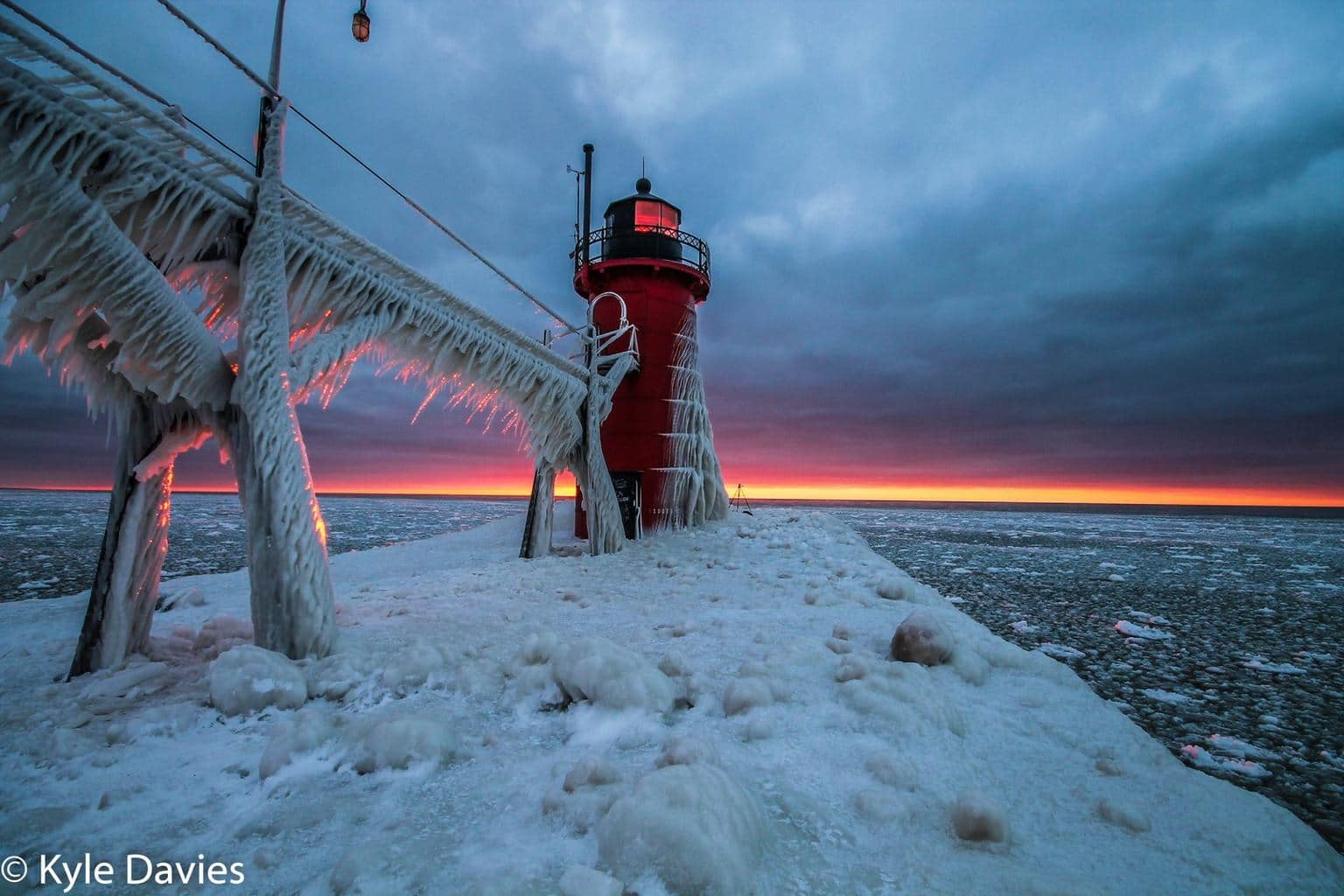 Lighthouse in Michigan encased in ice during sunset. Taken in January of 2013