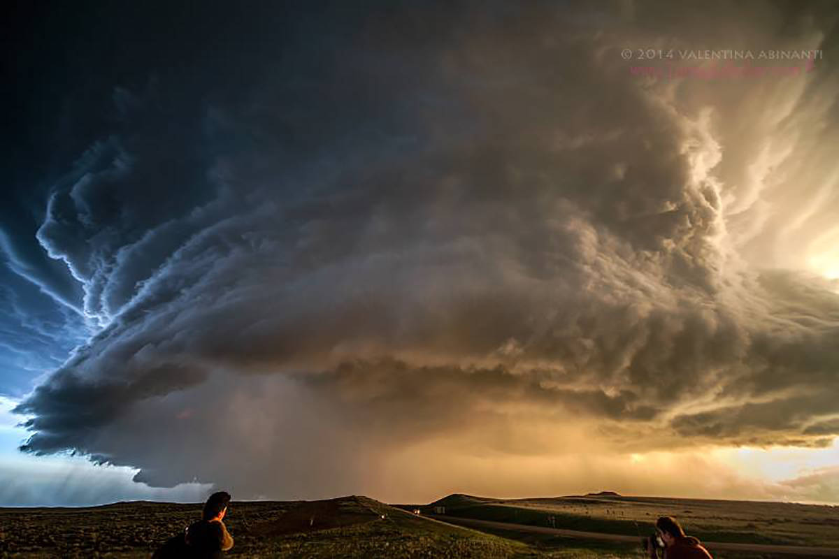 Supercell at sunset, Broadus, Montana, May 18th 2014.  My friends William and Jacopo are also in the pic.