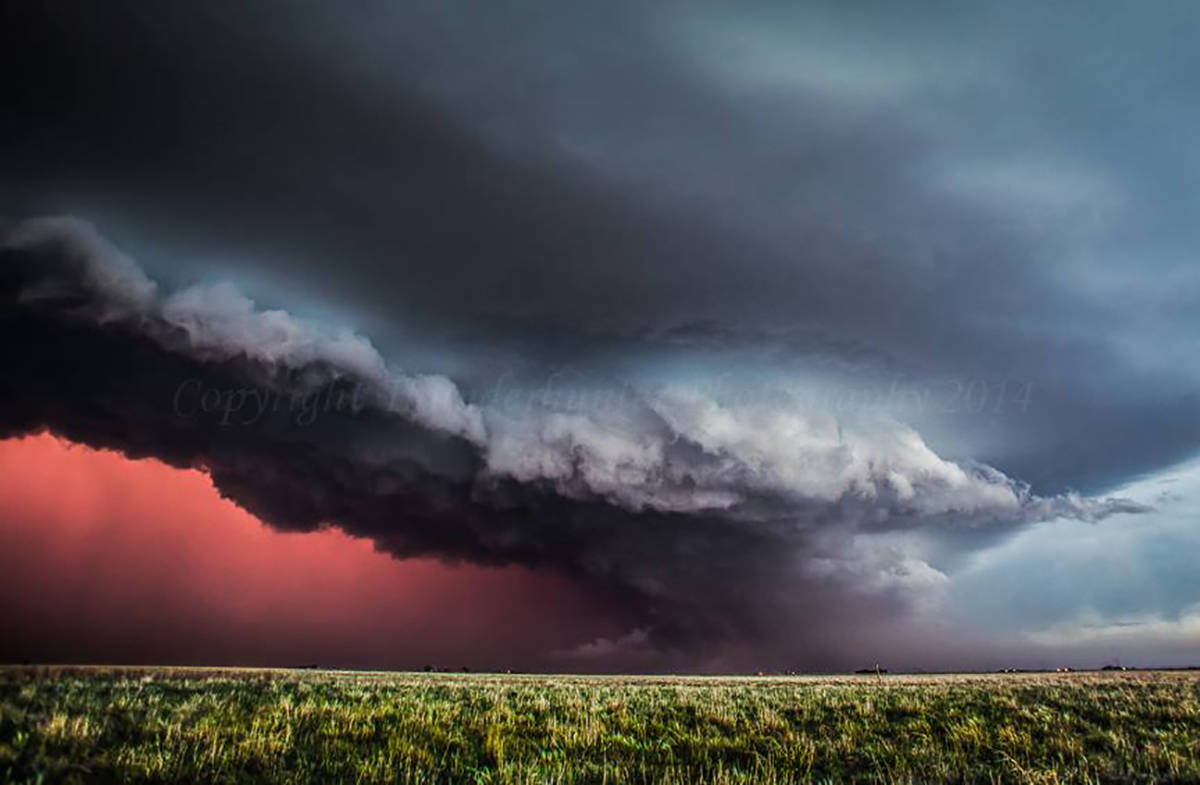 Pink lightning at sunset illuminates the core of this supercell in Texas on 5th June 2013.