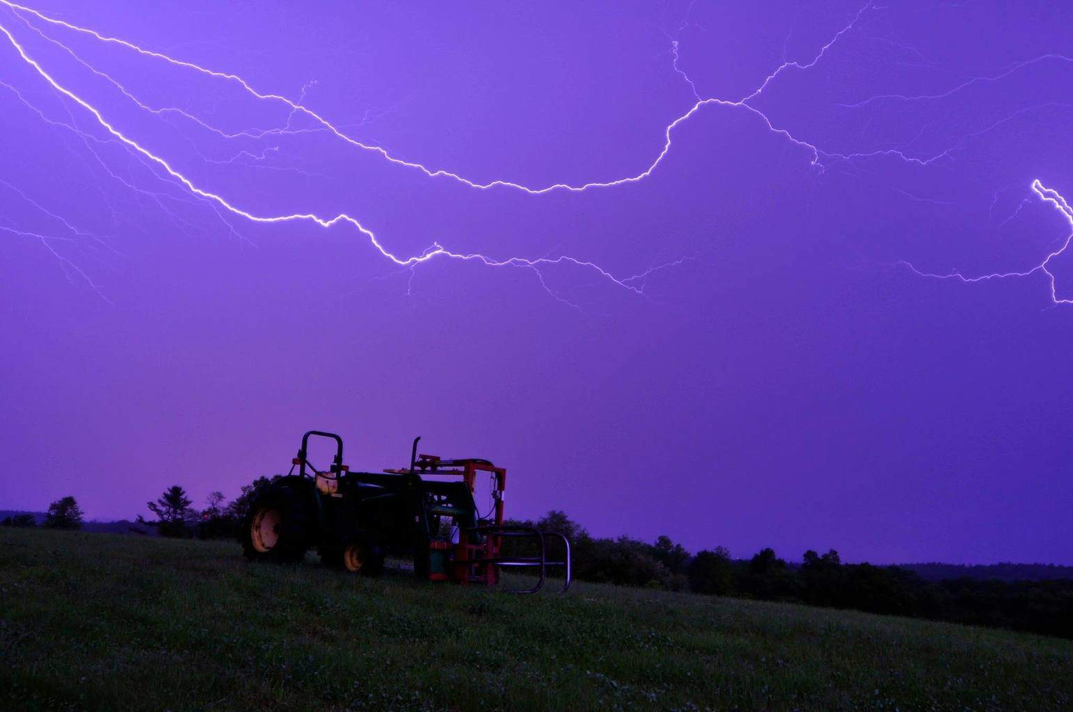Oh Deere the sky is purple and full of lightning. Charlton, Ma. May 30 2013