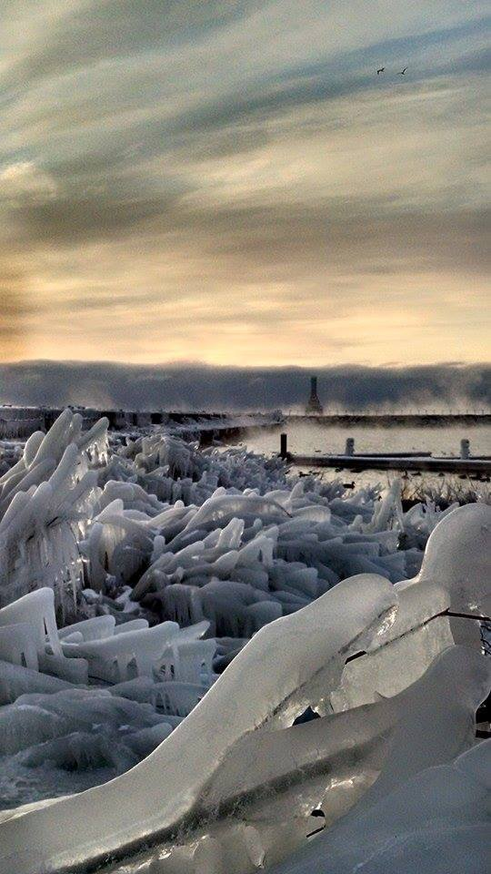 Stunning ice formations along the break wall in the harbor for this morning sunrise. Downtown Port Washington Wisconsin.