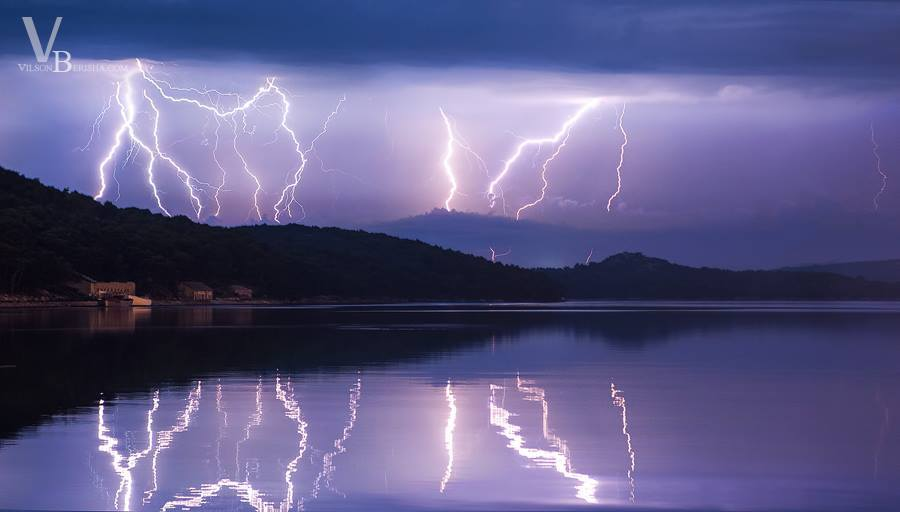 Morning storm, with spectacular lightning along the calm sea...makes awesome mirror effect 10/09/2014 Island Losinj Croatia