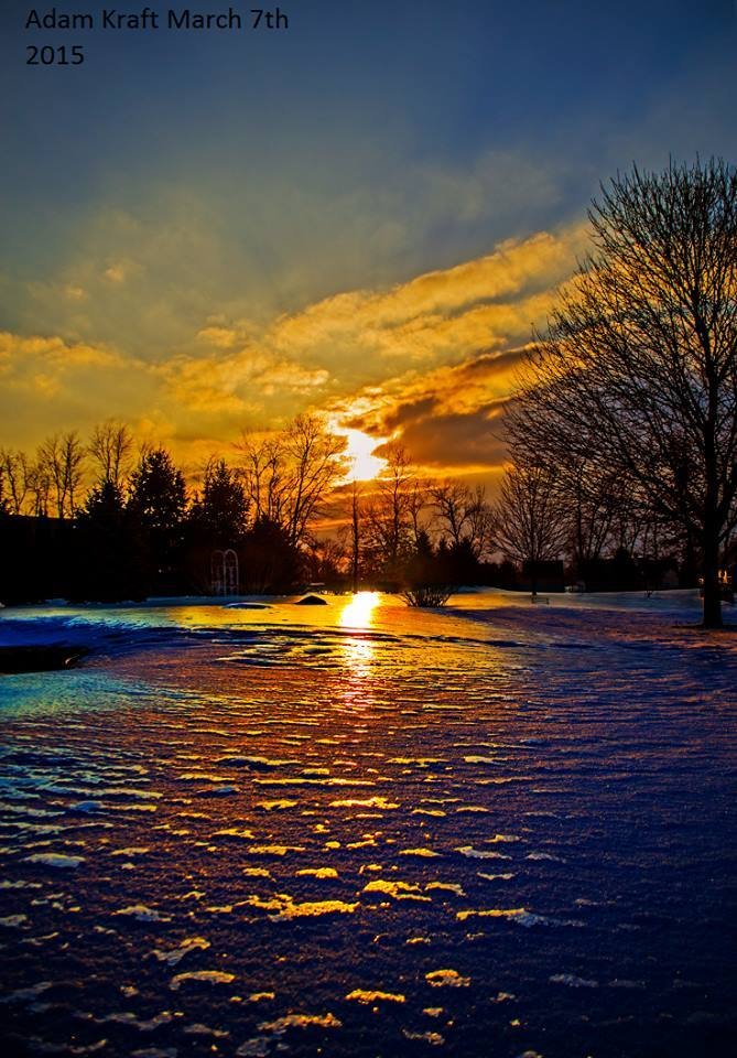 As temps warmed into the 40s today it melted a lot of the ice we had on the snow but with that melting gave me one of the best most unique sunset photo ops have ever had. Taken in Spring Arbor MI this evening.