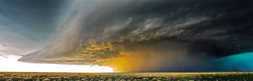 This long lived tornadic supercell produced powerful anvil bolts ahead of the storm and the smoke was drawn back into the updraft as the sun backlit the core. It would produce a tornado near Guymon, Oklahoma - May 31st 2007.