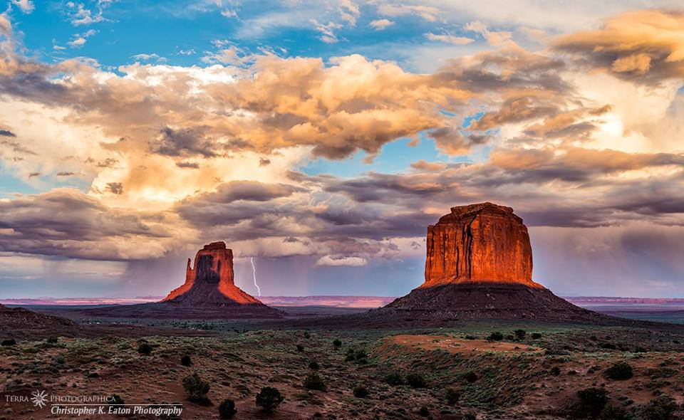For a few days twice a year – shortly after the Spring Equinox and shortly before the Autumnal Equinox – The sun is perfectly positioned at sunset over Monument Valley for the West Mitten to cast its long shadow onto the East Mitten. On September 13, 2013, the day was perfect for capturing both this phenomenon and a monsoon thunderstorm rolling in from the southwest