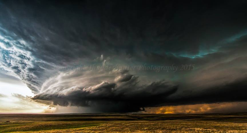 Wide angle of the mature stage of an incredible long-lived supercell west of Limon on June 7th 2012. I was very close at this point and was struggling to stand up in the extreme inflow. The broadscale rotation was amazing and the beaver tail seemed to stretch all the way to Kansas