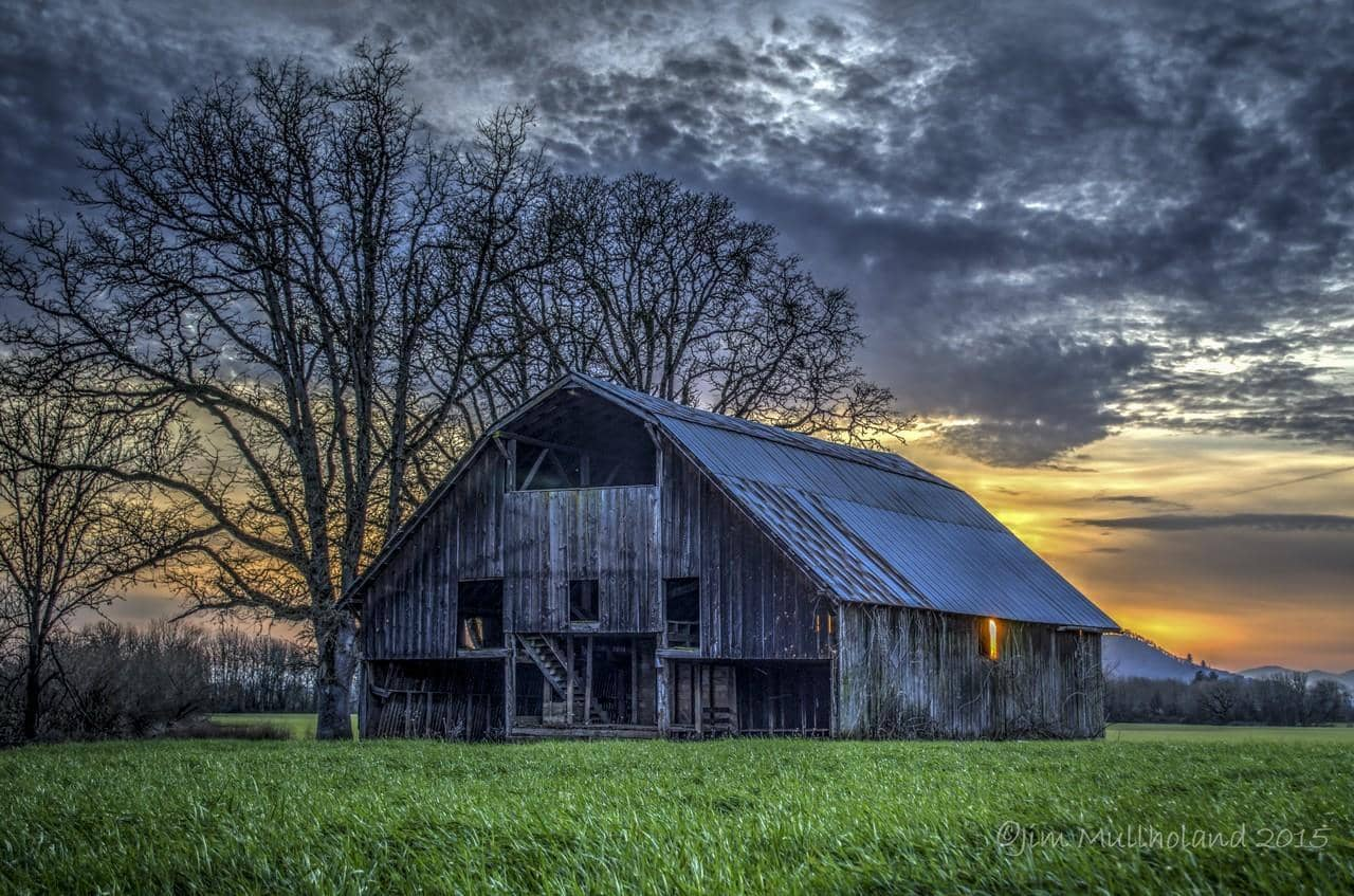 When I arrived at this location the sun was just setting behind this old barn and lined up perfectly with the side window of the barn. This is located about 5 miles west of Lebanon, Oregon in the Willamette Valley.