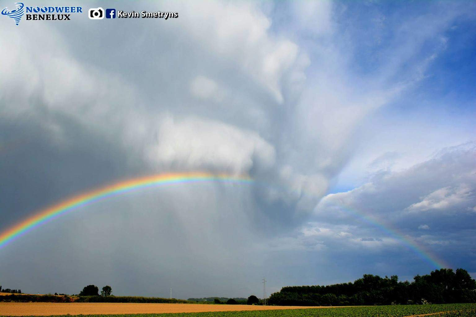 Thanks for accepting! Picture included was taken last year, may 23th 2014 in Essene, Belgium. After having quite a bust chase, me ( Kevin Smetryns Photography & Stormchasing ) and my friend from Severe Weather in Belgium decided to return home when a rainbow took shape... ) So we searched for a fine viewing spot aaaand, not such a bust after all!