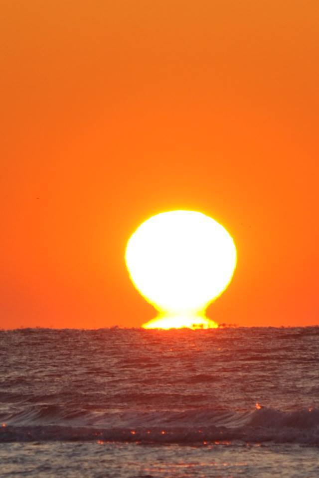 The Sun giving Mother Earth a good morning kiss,at Crystal Beach Texas, yall have a good day !!!!!!!!!!