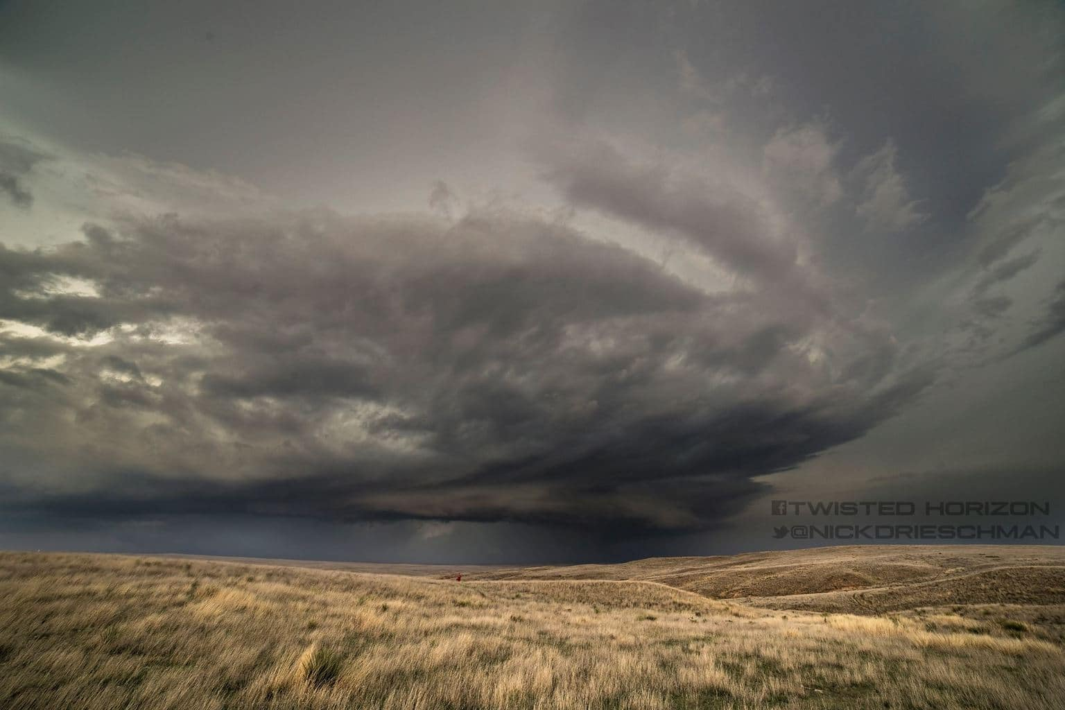 A peaceful scene near Tribune Kansas on a pretty storm over the grasslands 4-15-2015