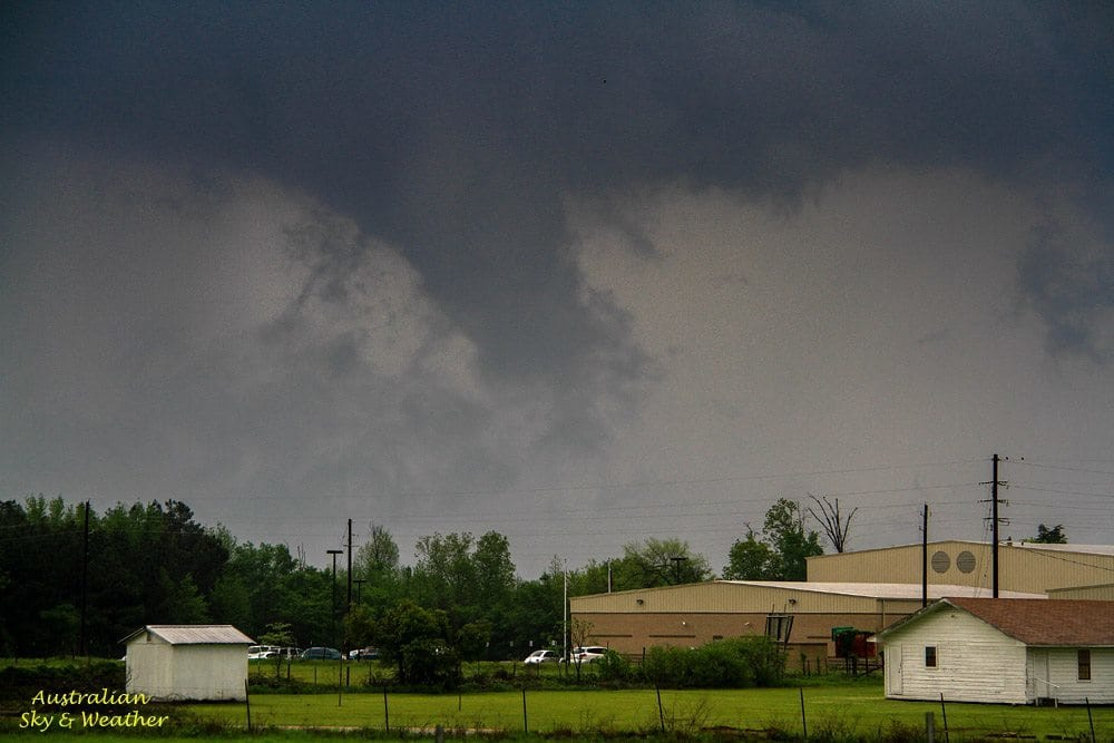 A brief funnel spins under a retreating wall cloud..Linden, Texas. This supercell topped up over 50,000'!! 9th April 2015