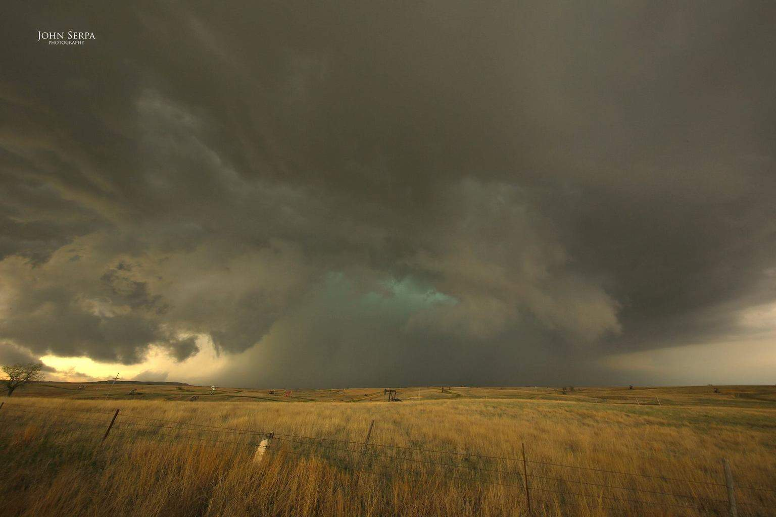 Hail to Kansas! An HP supercell covers the prairie with tennis ball size hail. I shot this photo yesterday a mile or so southwest of Lucas, KS.