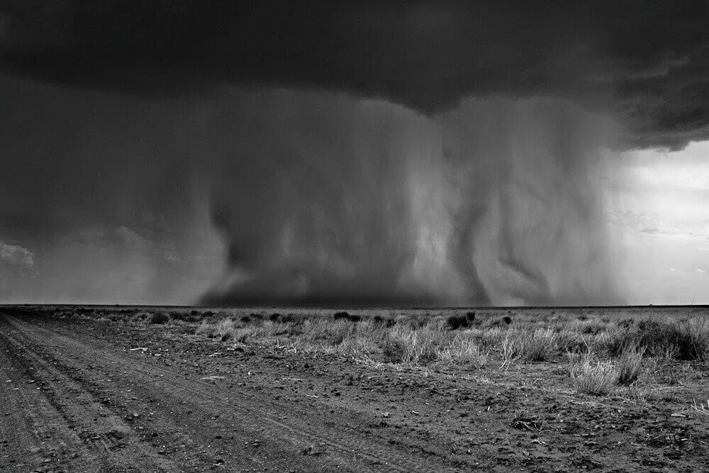 A black and White re edit of an old favorite.. Ilfracombe Queensland. This was a crazy situation. The rain this produced made the road very sticky.  Had to high tail out of there to get back to the sealed road..