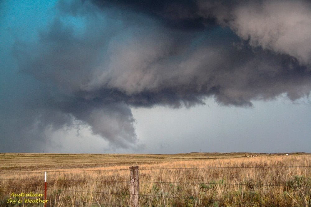 A large funnel spins under a large wall cloud Panhandle HP supercell Texas 16th April, 2015