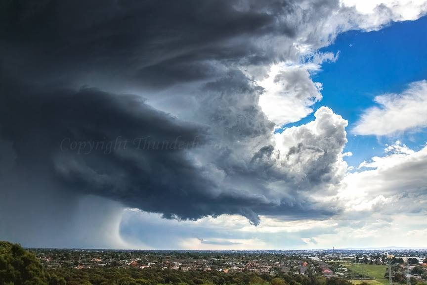 Supercell over Melbourne smashing the suburbs with baseball hail and an incredible rain/hail foot. There are another two supercells looming in the background on Christmas Day 2011. Melbourne, Australia.